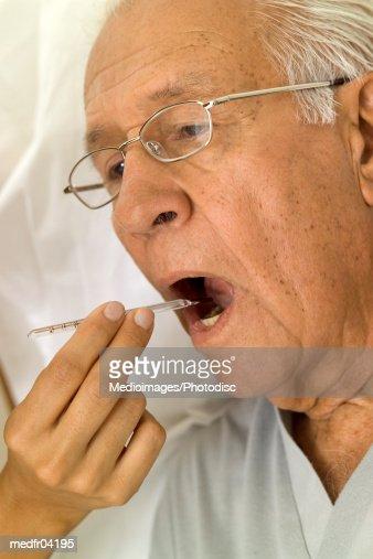 Temperature of elderly man being checked