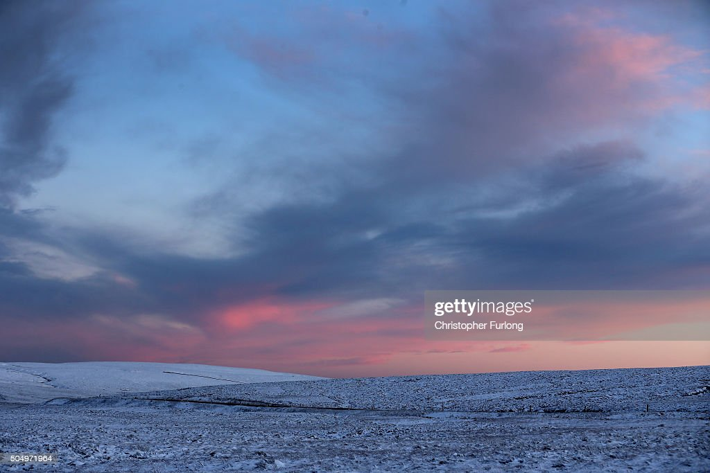 Temperatures drop as night time falls and snow blankets moors in the Peak District near Buxton on January 14, 2016 in Buxton, England. Overnight snowfall on the high ground of the Peak District caused disruption in some areas this morning. The Met office has issued weather warnings for snow and low temperatures creating hazardous conditions on untreated roads in some areas of the UK.