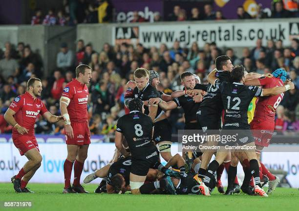 Tempers flair between Scarlets and Ospreys players during the Guinness Pro14 Round 6 match between Ospreys and Scarlets at Liberty Stadium on October...