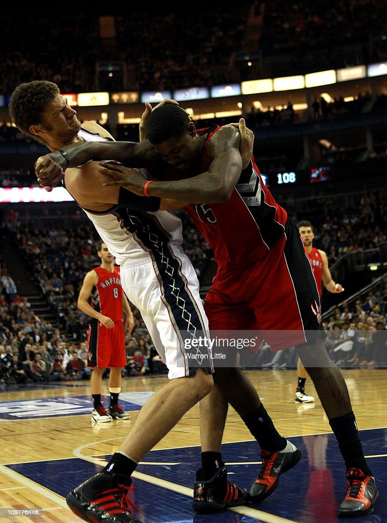 Tempers flare as <a gi-track='captionPersonalityLinkClicked' href=/galleries/search?phrase=Brook+Lopez&family=editorial&specificpeople=3847328 ng-click='$event.stopPropagation()'>Brook Lopez</a> #11 of the Nets and <a gi-track='captionPersonalityLinkClicked' href=/galleries/search?phrase=Amir+Johnson&family=editorial&specificpeople=556786 ng-click='$event.stopPropagation()'>Amir Johnson</a> #15 of the Raptors clash during the NBA match between New Jersey Nets and the Toronto Raptors at the O2 Arena on March 4, 2011 in London, England.