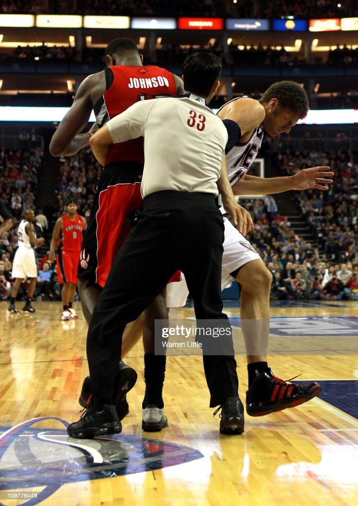 Tempers flare as Brook Lopez #11 of the Nets and Amir Johnson #15 of the Raptors clash during the NBA match between New Jersey Nets and the Toronto Raptors at the O2 Arena on March 4, 2011 in London, England.