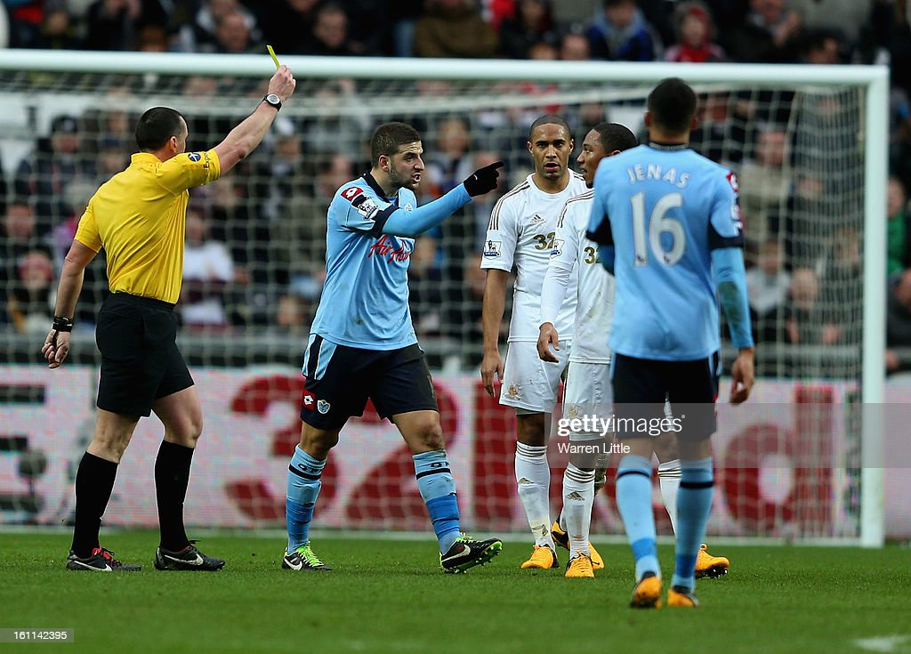 Tempers flare between Adel Taarabt of Queens Park Rangers and Jonathan de Guzman of Swansea City during the Premier League match between Swansea City and Queens Park Rangers at Liberty Stadium on February 9, 2013 in Swansea, Wales.
