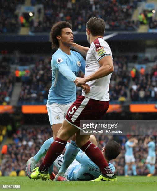 Tempers flare between Manchester City's Leroy Sane and Burnley's James Tarkowski after the penalty is awarded during the Premier League match at the...