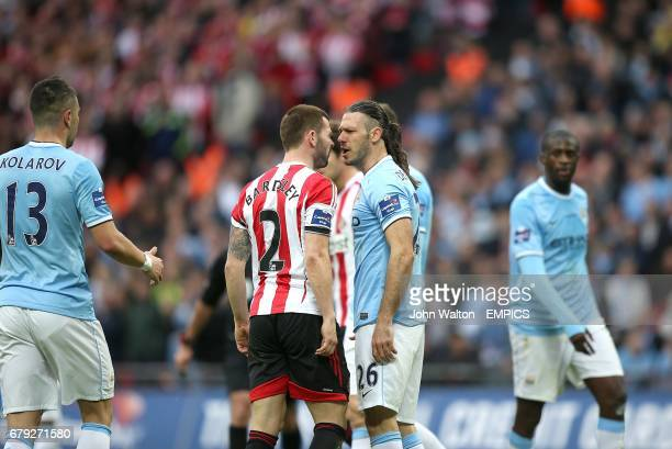 Tempers flare between Manchester City's Martin Demichelis and Sunderland's Phil Bardsley