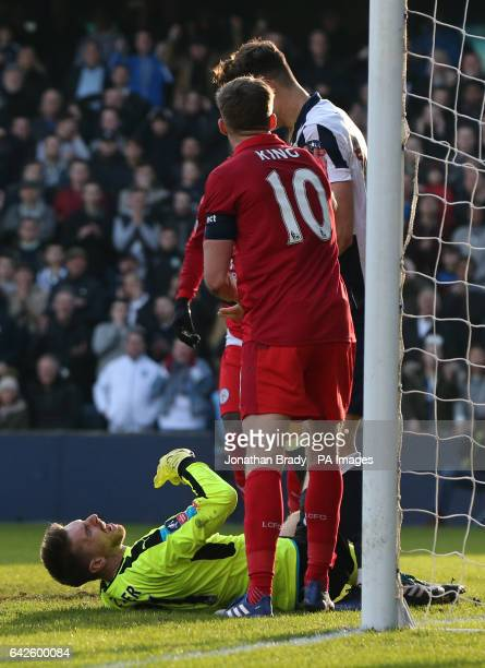 Tempers flare between Millwall's Jake Cooper and Leicester City goalkeeper RonRobert Zieler during the Emirates FA Cup Fifth Round match at The Den...