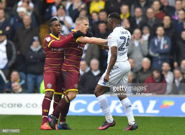 Tempers flare between Queens Park Rangers' Jake Bidwell and Leeds United's Hadi Sacko during the Sky Bet Championship match at Elland Road Leeds