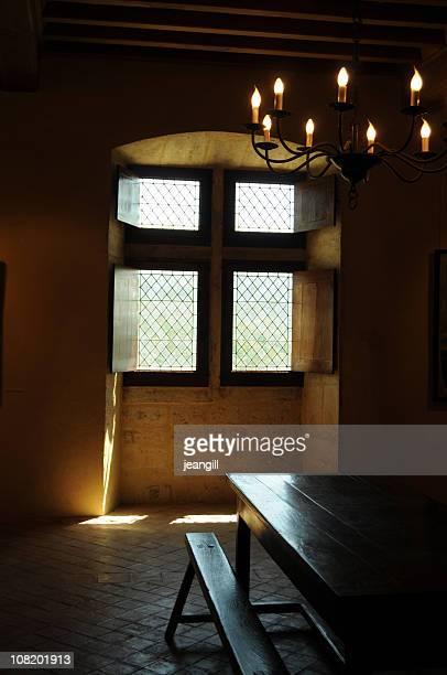 Templar cross in window of Provencal chateau