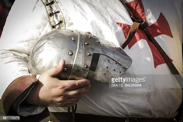 Templar knight wearing a helmet with visor Crusades 13th century Historical reenactment Detail