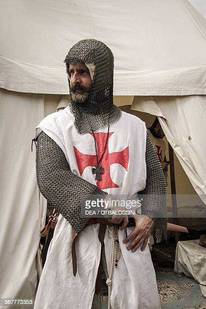 Templar knight wearing a white tunic chain mail and sword Crusades 13th century Historical reenactment