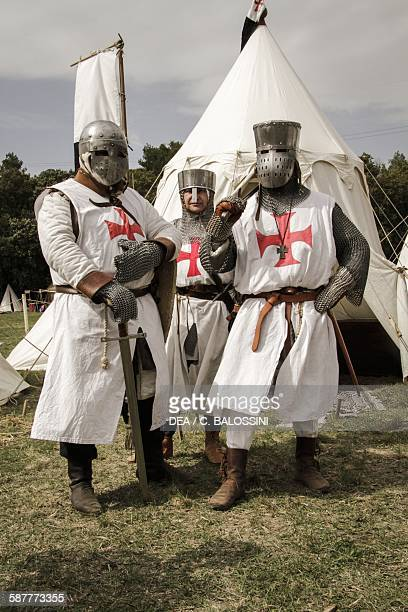 Templar knights wearing helmets white tunics chain mail and swords Crusades 13th century Historical reenactment