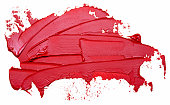 Template for your banner text - textured red oil paint brush stroke, isolated on white background. Red lipstick sample.