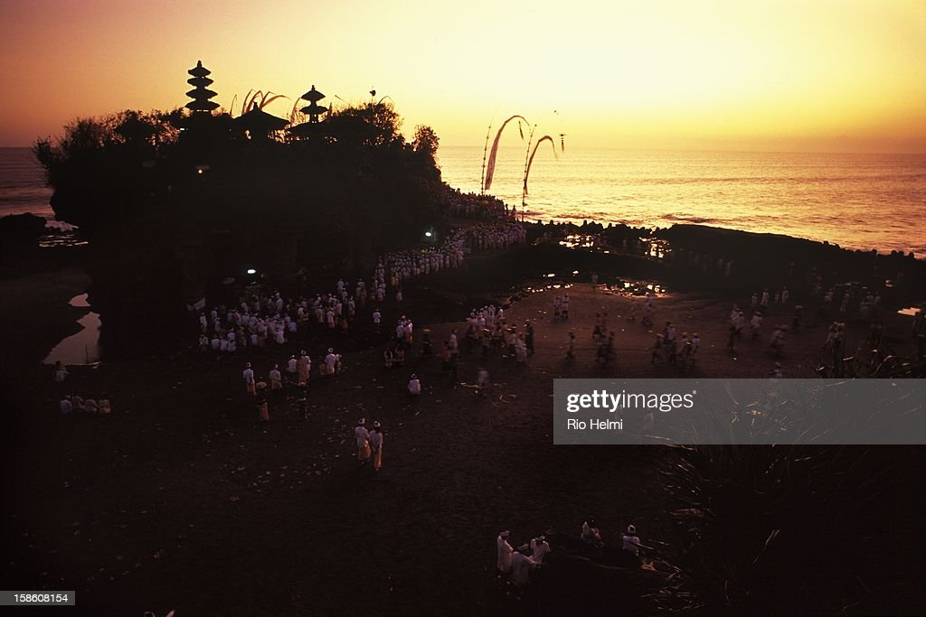 A temple festival at Tanah Lot, one of Bali's most popular tourist destinations on the west coast..