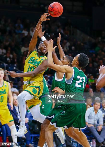 Temple Gibbs of the Notre Dame Fighting Irish passes the ball off over Cameron Bowles of the Chicago State Cougars at Purcell Pavilion on November 16...