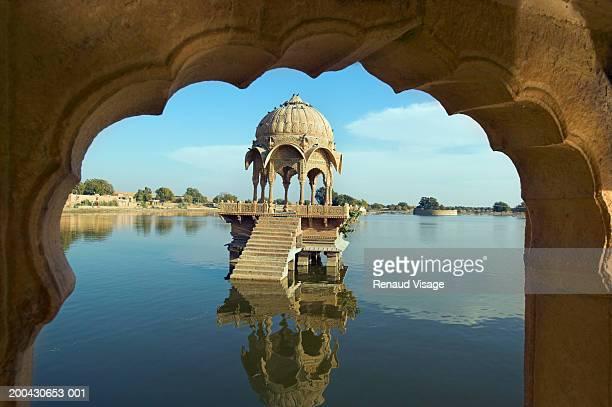 Temple in Gadi Sagar Lake, viewed through archway