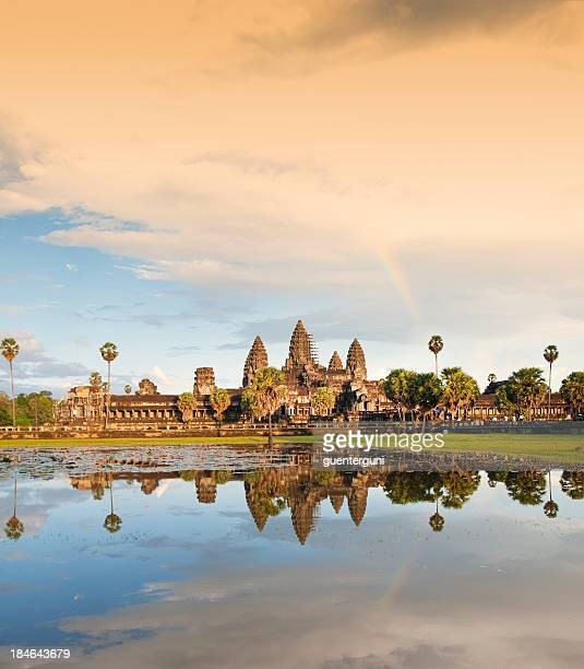 Temple of Angkor Wat with rainbow the evening sun