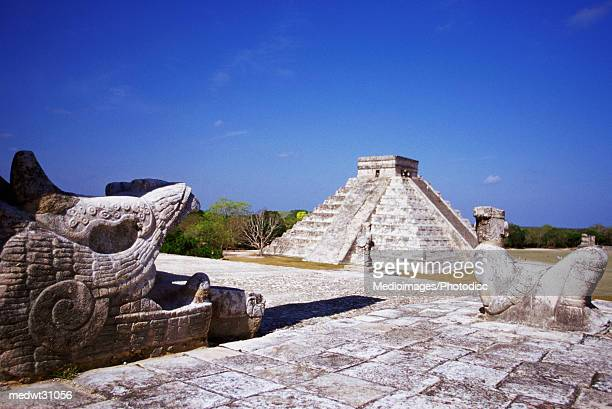 Temple of the Warriors Chac-Mool Statues, with view of Pyramid of Kukulkan at Chichen Itza, Yucatan, Mexico