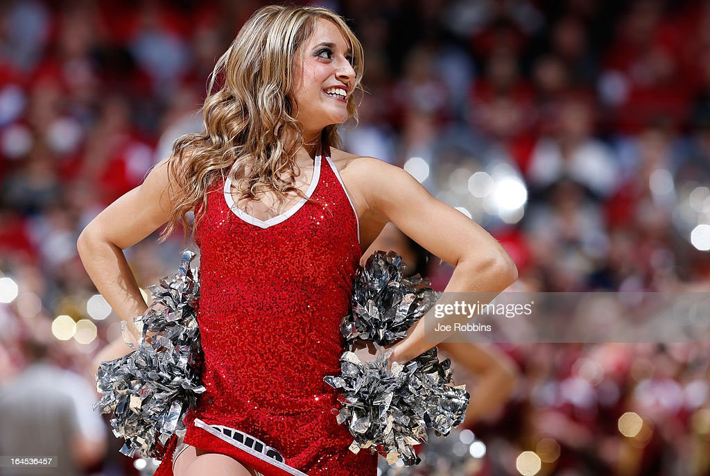 A Temple Owls cheerleader performs during a game stoppage in the first half against the Indiana Hoosiers during the third round of the 2013 NCAA Men's Basketball Tournament at UD Arena on March 24, 2013 in Dayton, Ohio.