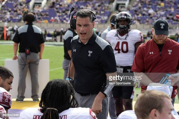 Temple Owls defensive line coach Jim Panagos talks to his players on the sidelines during a game between the Temple Owls and the East Carolina...