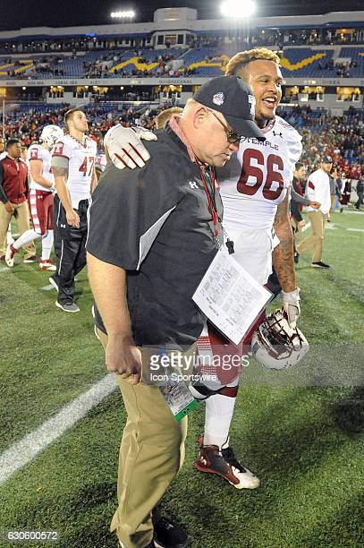 Temple Owls head coach Ed Foley is consoled by Temple Owls offensive lineman Dion Dawkins following the game on December 27 at Navy Marine Corps...