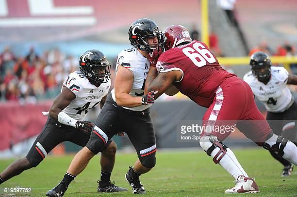 Temple Owls offensive lineman Dion Dawkins blocks Cincinnati Bearcats defensive end Caleb Ashworth during an NCAA football game between the...