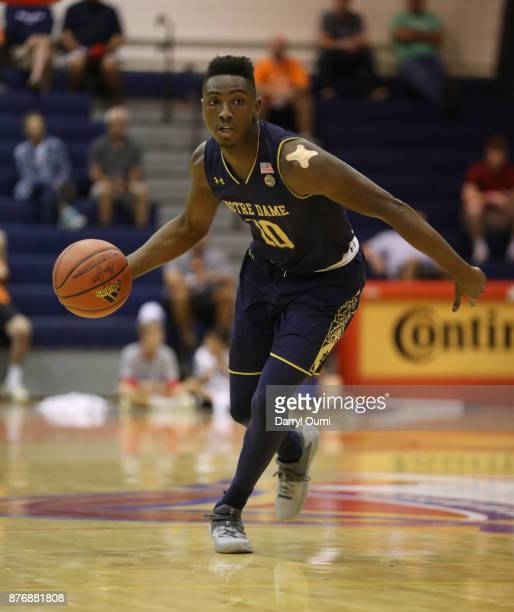 Temple 'TJ' Gibbs Jr #10 of the Notre Dame Fighting Irish dribbles the ball during the first half of the game against the Chaminade Silverswords at...