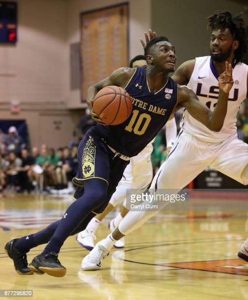 Temple 'TJ' Gibbs Jr #10 of the Notre Dame Fighting Irish drives to the basket during the first half of the game against the LSU Tigers during the...