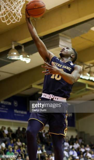 Temple 'TJ' Gibbs Jr #10 of the Notre Dame Fighting Irish lays the ball in during the second half of the game against the Chaminade Silverswords at...