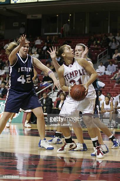 Temples Ari Moore had 13 points during a 63 to 46 Temple Owl victory over the Penn Quakers at the Liacouras Ctr in Philadelphia Pennsylvania on...