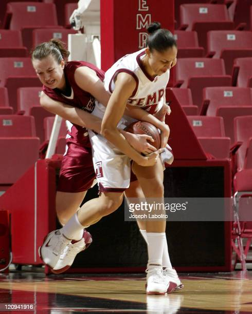 Temple's Candice Dupree wrestles the ball away from UMass's Katie Mills during a Temple Owls 59 to 43 victory over the University of Massachusetts...