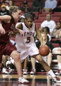 Temple's Kadija Bowens drives past Umass's Katie Mills during a Temple Owls 59 to 43 victory over the University of Massachusetts Minutewomen at the...