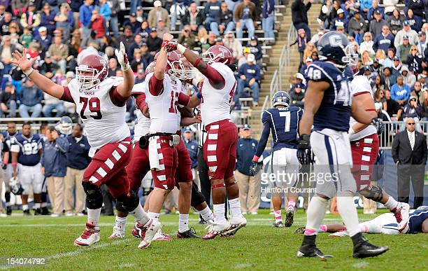 Temple's Kyle Friend place holder Connor Reilly and fullback Wyatt Benson celebrate after Brandon McManus kicked the winning field goal in overtime...