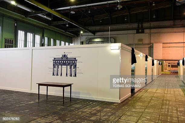 Temporary bedrooms are pictured at a refugee accomodation hosted in the hangar two of the former Tempelhof airport in Berlin on December 26 2015 /...