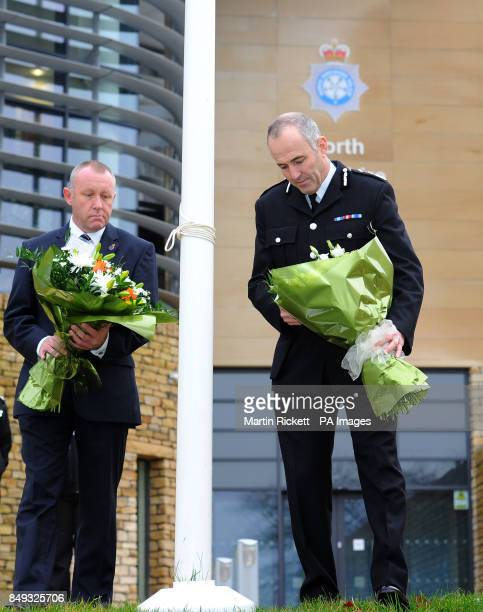 Temporary Chief Constable Tim Madgwick and Mike Stubbs from the North Yorkshire Police Federation lay flowers outside Harrogate Police Station after...