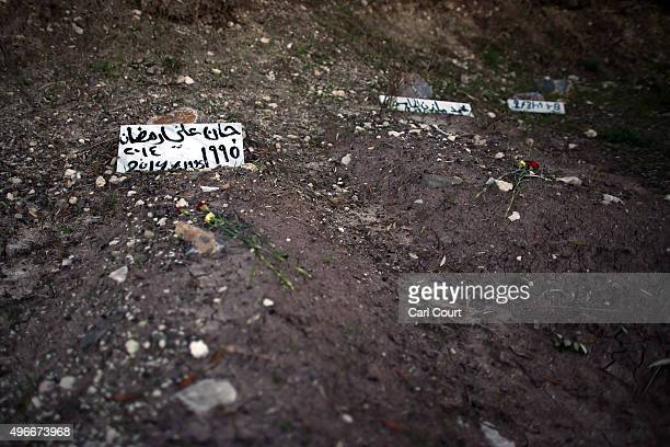 Temporary headstones mark the grave of migrants who died attempting to cross from Turkey to the Greek island of Lesbos after their burial in Agios...