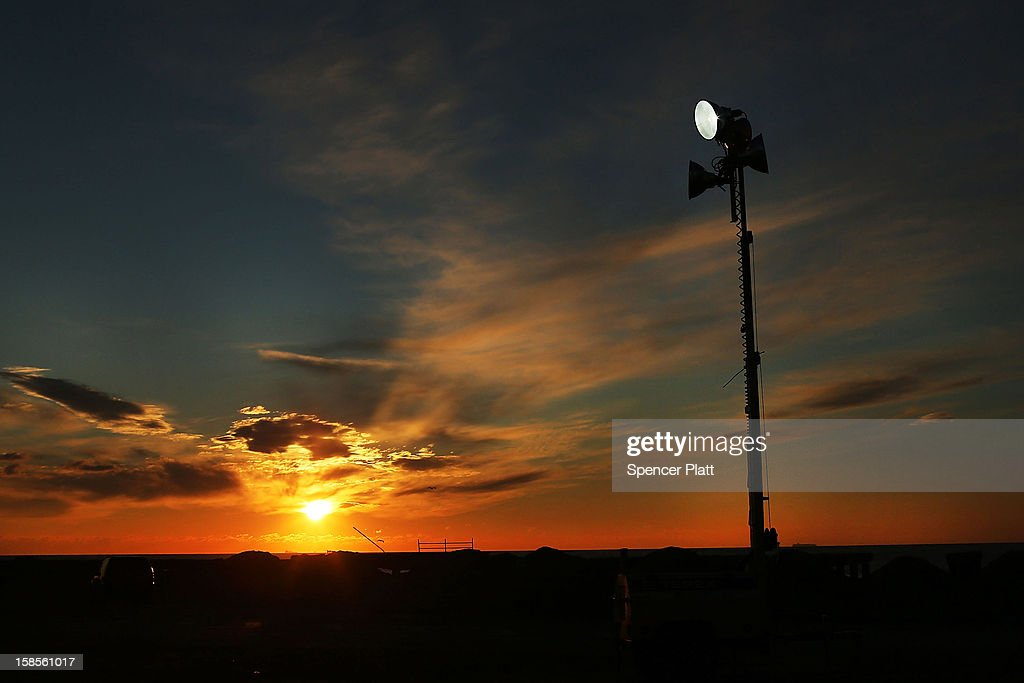 A temporary police department street lamp, working off of a generator, is viewed at dawn on November 19, 2012 in the Queens borough of New York City. As the holidays approach after Superstorm Sandy slammed into parts of New York and New Jersey, thousands of residents and businesses are still recovering from the devastation.
