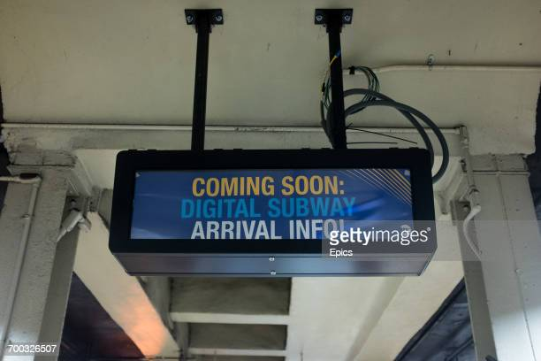 A temporary sign announcing that digital arrival information for subways will soon be available in the underground station the sign reads 'coming...