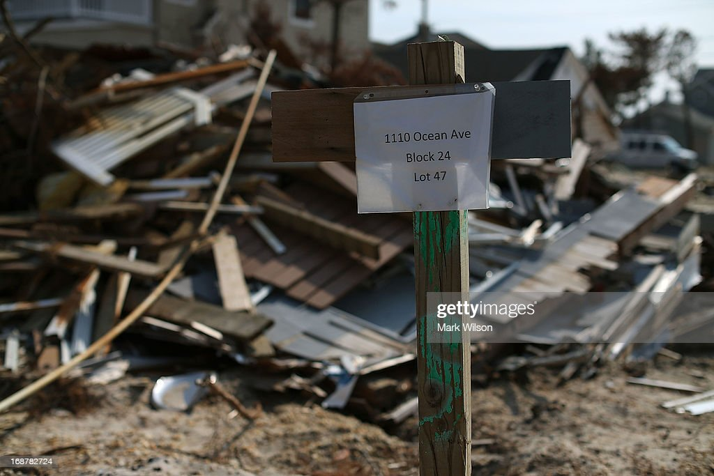 A temporary sign marks the address of a home damaged by Superstorm Sandy as it waits to be torn down, May 15, 2013 in Manotoloking, New Jersey. Mantoloking officials say that at least 50 homes are scheduled to be demolished in the up coming weeks.