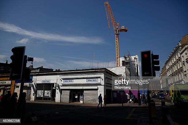 Temporary signs hang outside a building site during construction work carried out by Balfour Beatty Plc in the King's Cross district of London UK on...