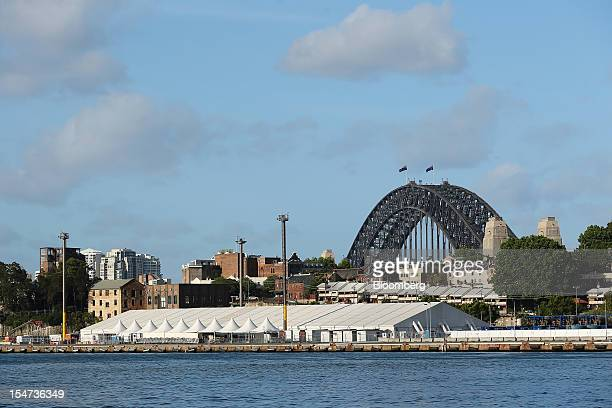 Temporary structures stand at the Barangaroo redevelopment project front as the Sydney Harbour Bridge stands in the background in Sydney Australia on...