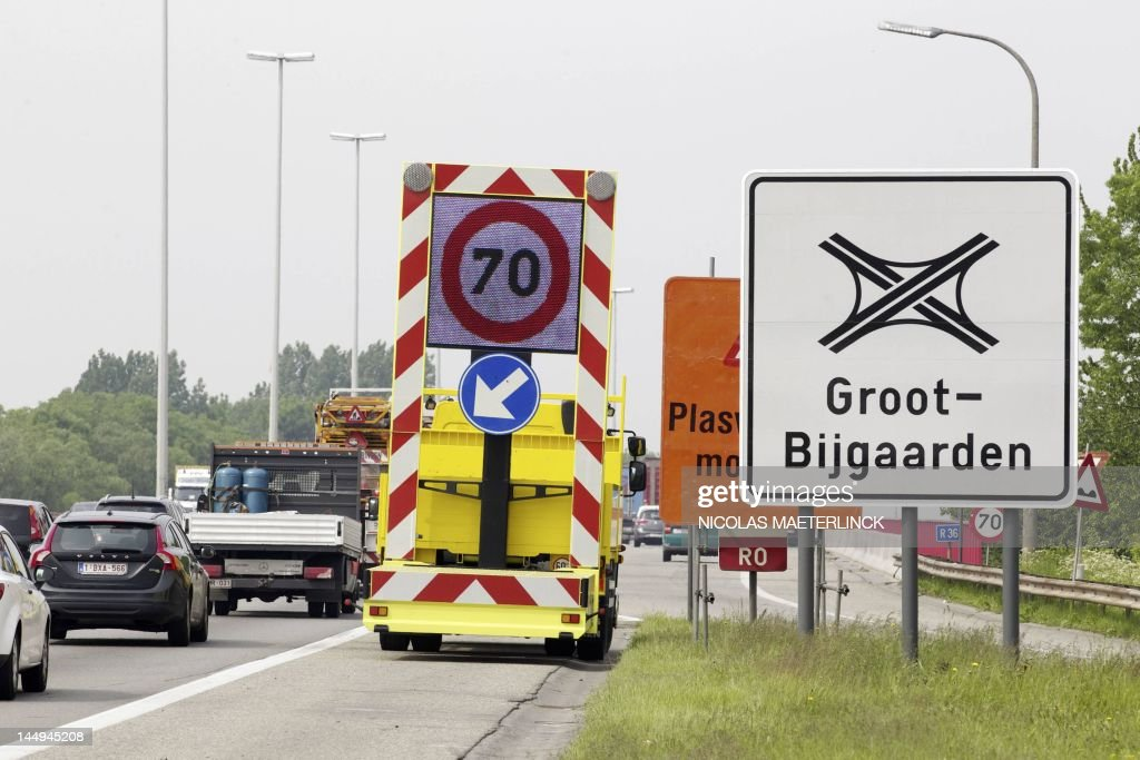 A temporary traffic sign indicates that the speed limit is reduced to 70 km/h, during roadworks at the Brussels' Ring, on May 21, 2012. The renovation of the pavement of the Ring road cost the life of a motorcycle driver last week. Six out of ten vehicles that get controlled drive too fast, but critics say the signalization is insufficient.