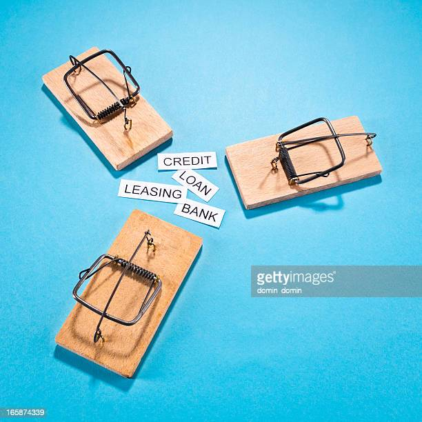 Temptation: mousetraps with loan, credit, leasing, bank, isolated on blue