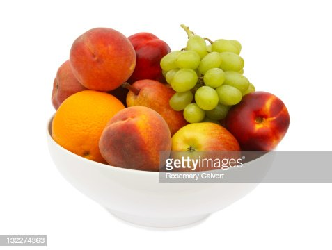 Tempting fresh fruit in white bowl. : Stock Photo