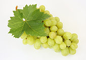 Tempting, ripe green grapes with leaf.