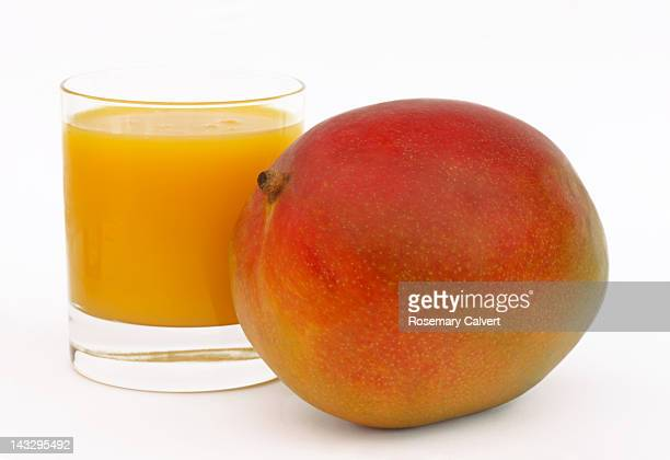 Tempting ripe mango and glass of mango juice