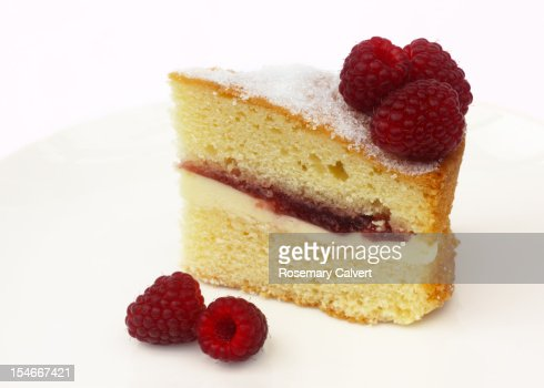 Tempting slice of Victoria sponge with raspberries : Stockfoto