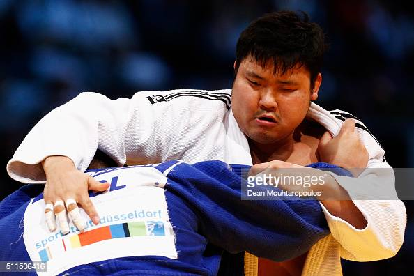Temuulen Battulga of Mongolia and SungMin Kim of South Korea compete during the Dusseldorf Judo Grand Prix in their Mens 100kg bout held at...