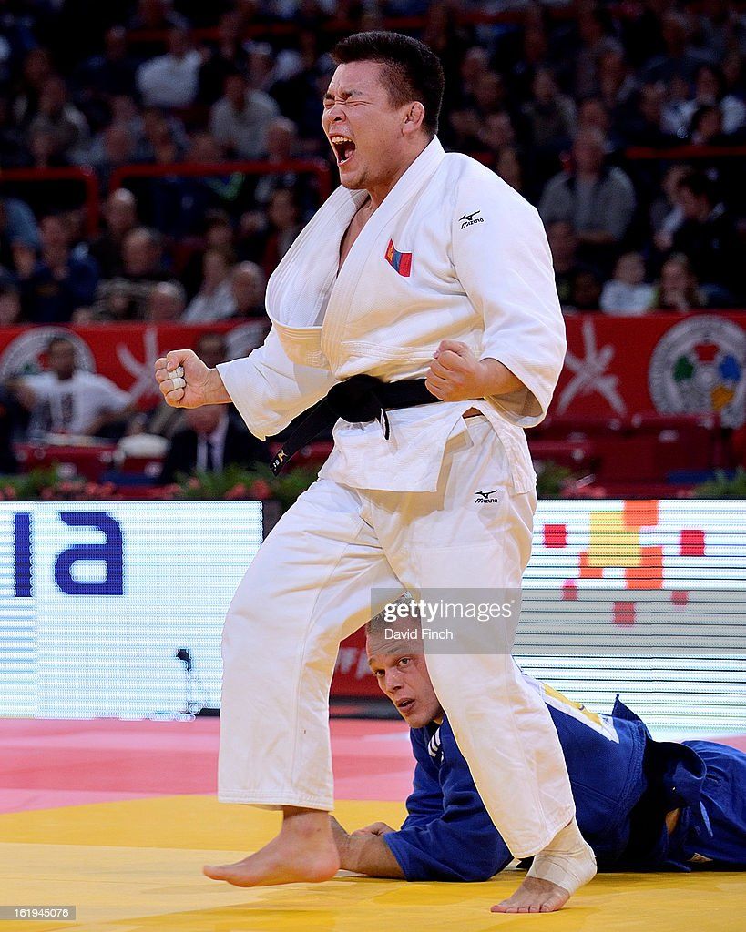 Temuulen Battulga of Mongolia (white) defeated <a gi-track='captionPersonalityLinkClicked' href=/galleries/search?phrase=Henk+Grol&family=editorial&specificpeople=4920749 ng-click='$event.stopPropagation()'>Henk Grol</a> of Holland by an ippon to reach the u100kgs final during the Paris Grand Slam on day 2, Sunday, February 10, 2013 at the Palais Omnisports de Paris, Bercy, Paris, France.