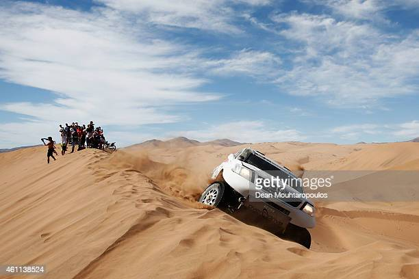 Ten Brinke Bernhard of the Netherlands and Tom Colsoul of Belgium for Toyota Overdrive Hiluz fail to make it over the sand dune on the first attempt...