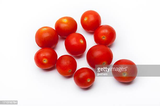 Ten Cherry tomatoes on a white surface
