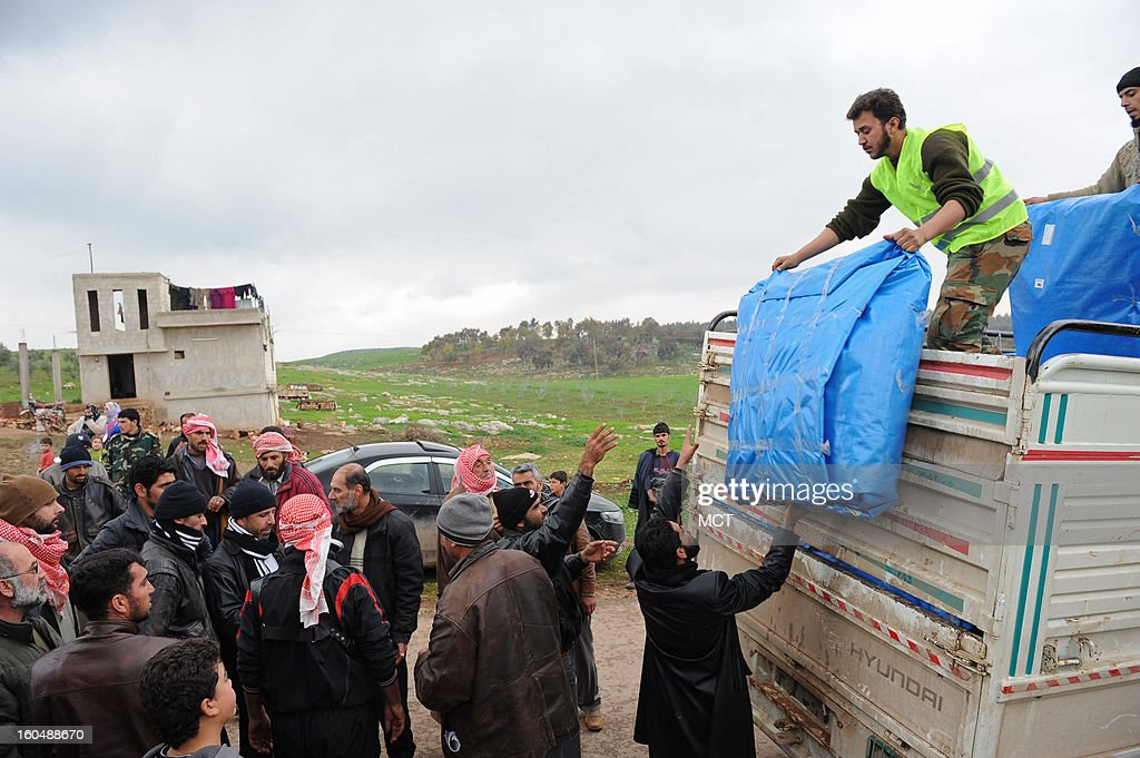 Ten days after more than 100,000 people fled a Syrian government bombardment of two towns in north Hama county, the Free Syrian Army's Farouk Brigade obtained a trucked of small tents to distribute to people still living in the open or in caves near al Aaharia.